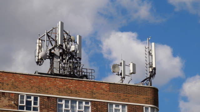 cell tower on rooftop for 5g mobile phone and communication technologies - antenna aerial stock videos & royalty-free footage