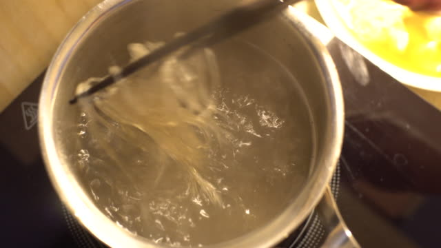 cellophane noodle rice noodle cooking - cellophane stock videos & royalty-free footage