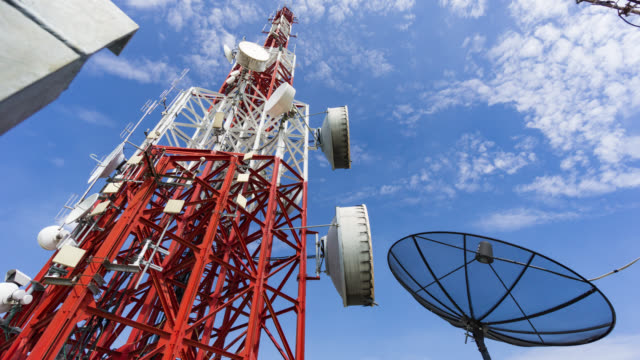 cellphone telecommunication tower time lapse - communications tower stock videos & royalty-free footage