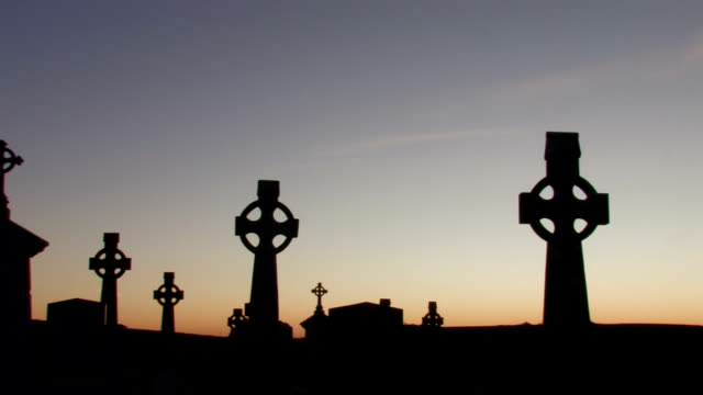 celtic crosses in graveyard at dawn - cross stock videos & royalty-free footage