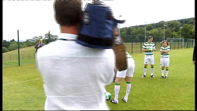 Glasgow EXT Celtic players Paul Hartley and Stephen McManus wearing new Celtic kit photocall with Scottish Premier League Trophy