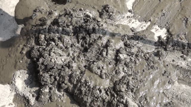 cement mix with sand for construction in slow motion - wet stock videos & royalty-free footage