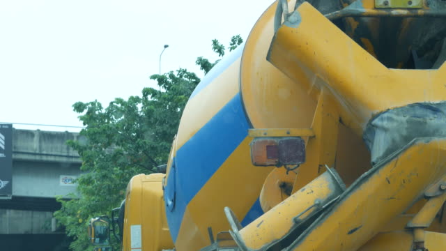 cement mixer truck mixing concrete , traffic jam - concrete stock videos & royalty-free footage