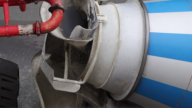 cement mixer truck unloading concrete at - cement mixer stock videos and b-roll footage