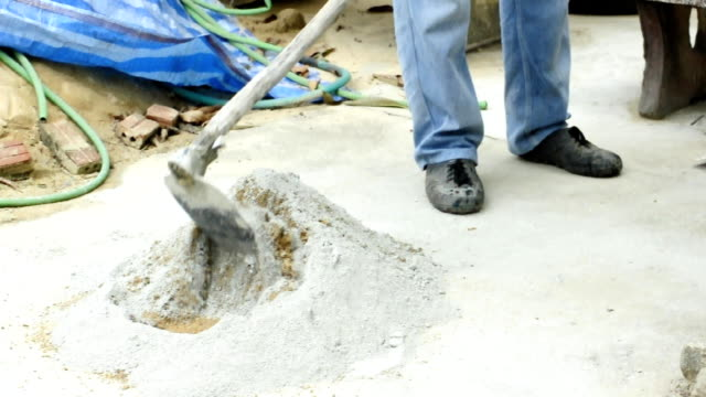 cement mixer with a shovel. - cement mixer stock videos & royalty-free footage