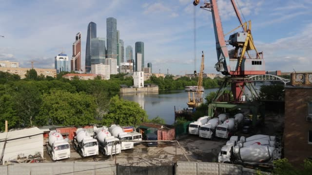 A cement truck depot stands on the banks of the Moskva River opposite the skyscrapers of the Moscow International Business Center also known as...