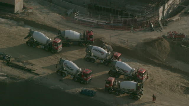 cement trucks on a construction site - medium group of objects stock videos & royalty-free footage