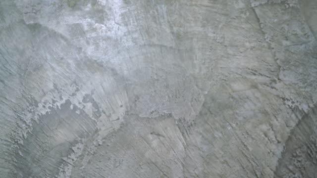 セメント壁背景スライディングショット - 起伏のある点の映像素材/bロール