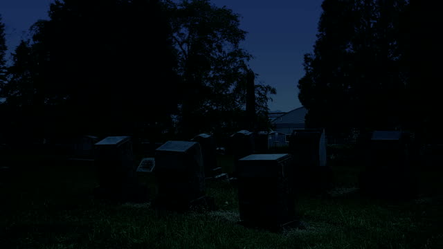 cementery gravestones at night - gravestone stock videos & royalty-free footage