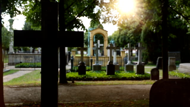 cemetery cross with sun - cemetery stock videos & royalty-free footage