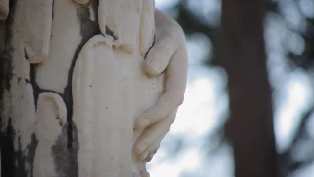 C/U Cemetery, hand of statue, tomb