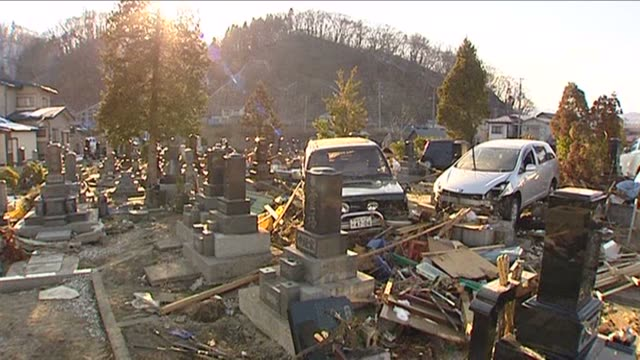 cemetery hit by tsunami japan march 2011 - grab stock-videos und b-roll-filmmaterial