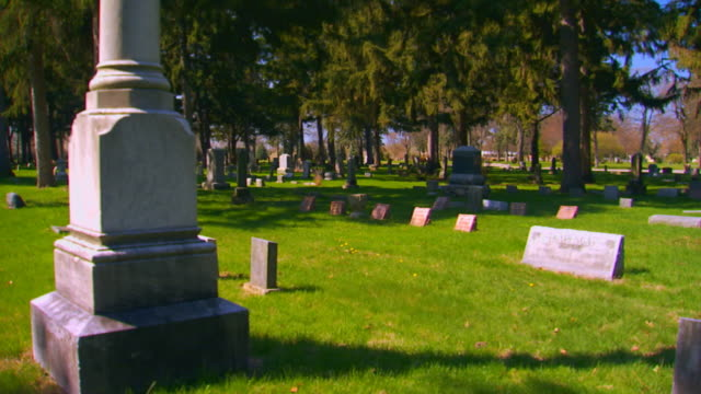cemetery monuments and grave stones, jib shot - jib shot stock videos & royalty-free footage