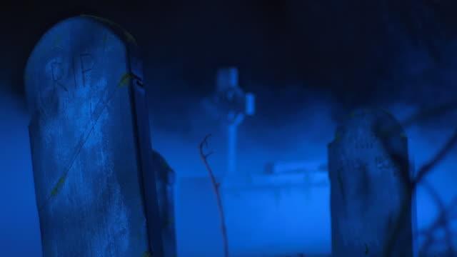 hd: cemetery tombstones shrouded in fog - gravestone stock videos & royalty-free footage
