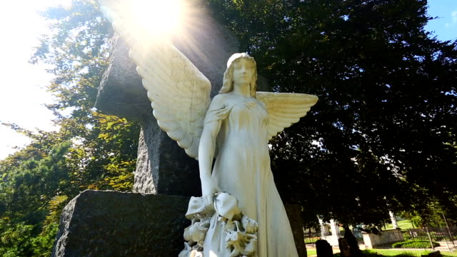 cemetery with angels and sun - cemetery stock videos & royalty-free footage