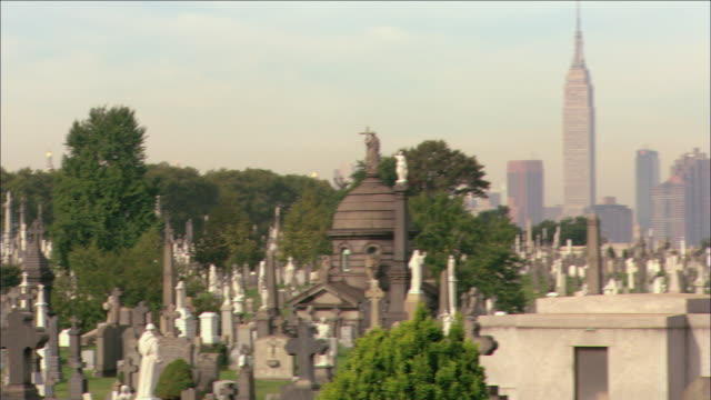 pan cemetery with crowds of headstones and statues standing / new york city, new york, united states - cemetery stock videos & royalty-free footage