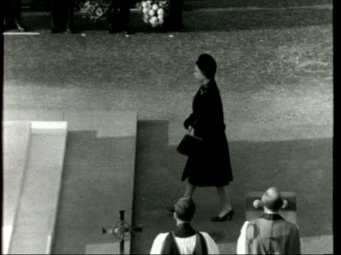 london whitehall a gv cenotaph as clergy come out ts queen elizabeth ii lays wreath rl steps back zoom into queen turns and walks back to place ts... - harold wilson stock-videos und b-roll-filmmaterial