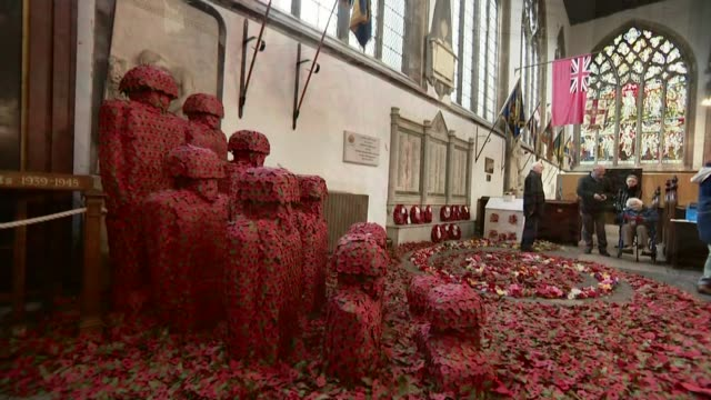 Commemorations across the UK ENGLAND Hull Hull Minster INT The Remembrance Installation by Martin Waters TILT Wide shot poppies in installation High...