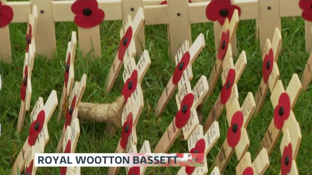 Commemorations across the UK ENGLAND Wiltshire Royal Wootton Bassett Lydiard Park EXT High angle wooden crosses planted in field PAN Miniature Wooden...