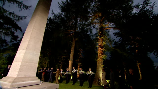 lanterns laid at german obelisk in cemetery belgium mons st symphorien ext / night vips along to memorial / archbishop of canterbury justin welby... - michael d. higgins stock videos and b-roll footage