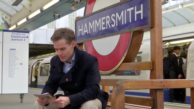 Letters by London transport workers who served as soldiers in WW1 published ENGLAND London Hammersmith Station EXT Man reading letter by London...
