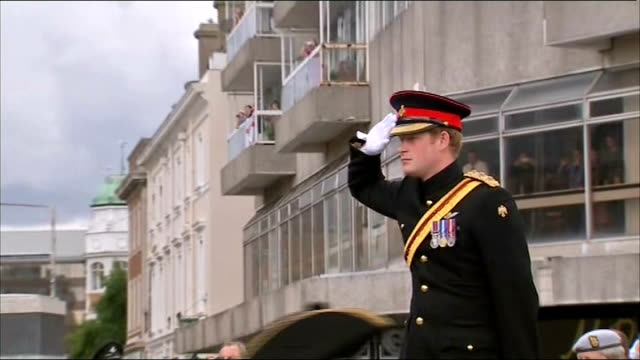centenary service attended by heads of state in liege / mons cemetery commemoration; england: kent: folkestone: ext prince harry taking the salute of... - 敬礼点の映像素材/bロール