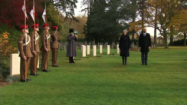 Theresa May and Emmanuel Macron honour fallen soldiers Belgium SaintSymphorien St Symphorien Military Cemetery Theresa May MP and Charles Michel...