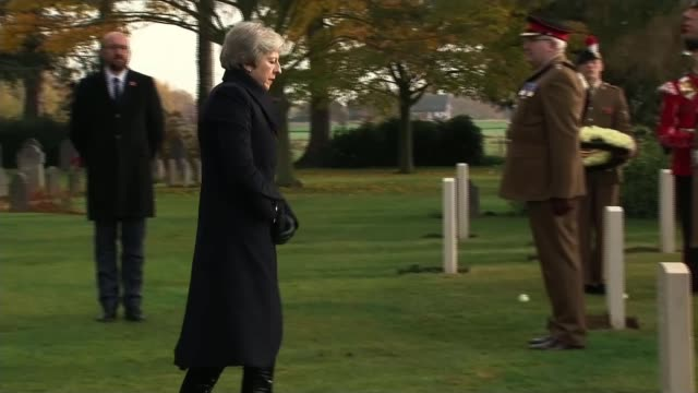 Theresa May and Emmanuel Macron honour fallen soldiers Belgium SaintSymphorien St Symphorien Military Cemetery Theresa May MP laying poppy wreaths on...