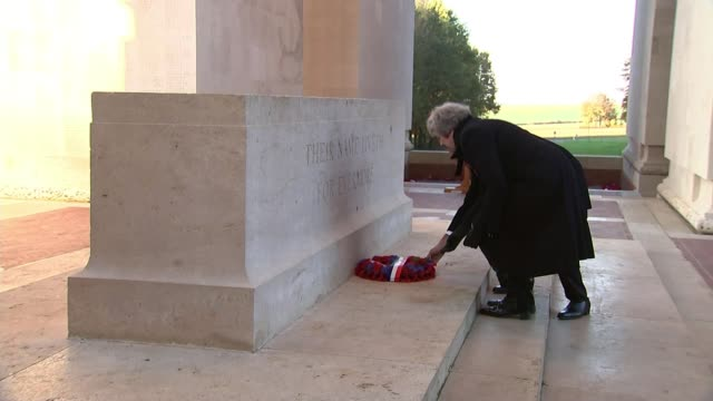 Theresa May and Emmanuel Macron honour fallen soldiers France HautsdeFrance Somme Authuille Theresa May MP and Emmanuel Macron laying wreath at...