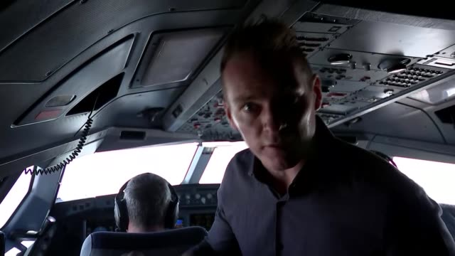 warning over years of cuts on defence budget uk pilots in cockpit / air to air planes seen through window england london pilots in cockpit hand on... - カット切り替え点の映像素材/bロール