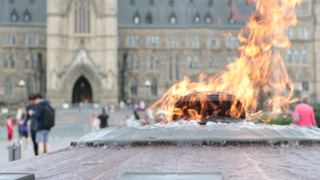 centennial flame and parliement building in ottawa, canada - ottawa stock videos & royalty-free footage