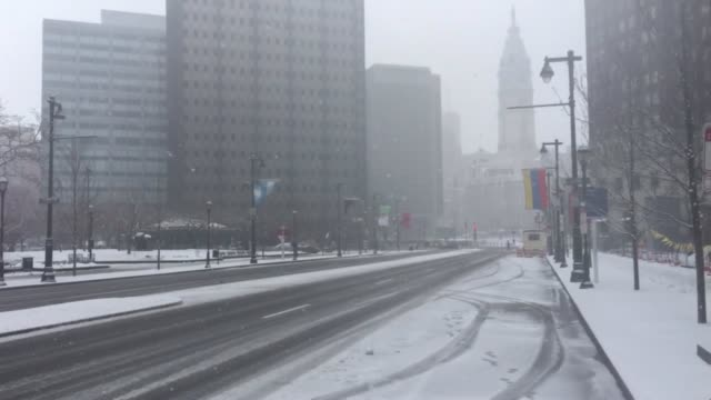 center city philadelphia is nearly a ghost town today due to the snow storm - center city philadelphia stock videos and b-roll footage