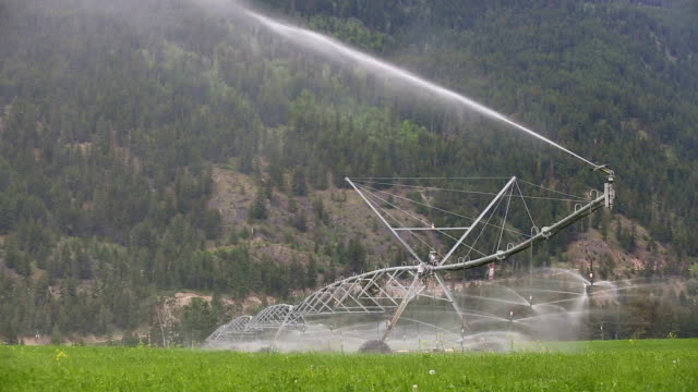 center pivot irrigation equipment - sprinkler system stock videos & royalty-free footage