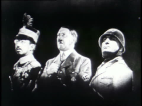 centered between images of mussolini and hirohito, adolf hitler promises a german crowd that they will become masters of the world; they respond with shouts of seig heil and the hitler salute. - benito mussolini stock videos & royalty-free footage
