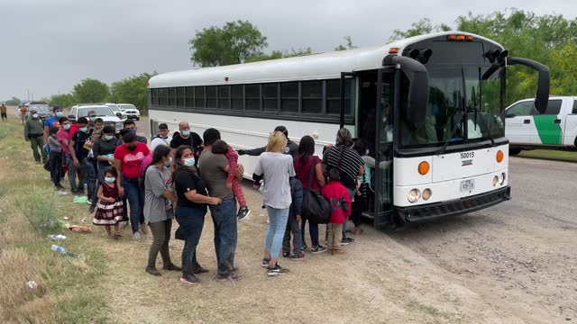 central american families board a u.s. customs and border protection bus for transport to an immigrant processing center after crossing the border... - crossing stock videos & royalty-free footage