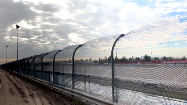 central american immigrants at the u.s.-mexico border fence on february 01, 2019 in el paso, texas. the migrants were taken into custody, seeking... - 国境点の映像素材/bロール