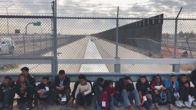 central american immigrants at the usmexico border fence on february 01 2019 in el paso texas the migrants were taken into custody seeking political... - international border barrier stock videos & royalty-free footage