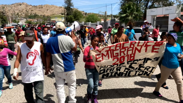 central american immigrants, part of an immigrant 'caravan,' march in protest against u.s. president donald trump on april 23, 2018 in hermosillo,... - human interest stock videos & royalty-free footage