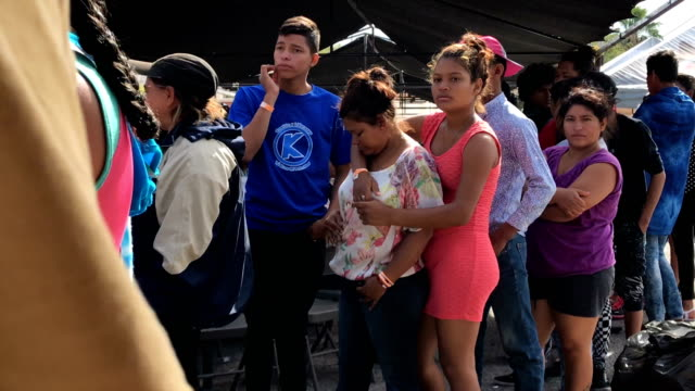 central american immigrants, part of an immigrant 'caravan,' march in protest against u.s. president donald trump on april 23, 2018 in hermosillo,... - national border stock videos & royalty-free footage