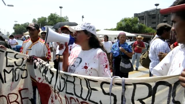 central american migrants and rights activists staged a protest in mexico city to urge the government to draw up laws to protect immigrants from drug... - other stock videos and b-roll footage