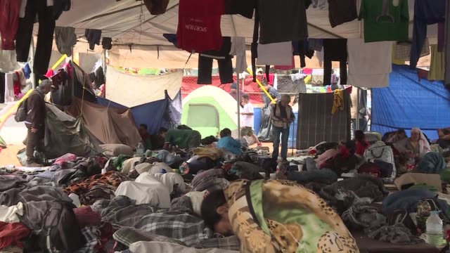 central american migrants are living in a shelter in the mexican border city of tijuana - tijuana stock videos & royalty-free footage