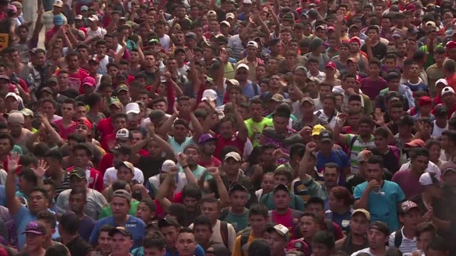 Central American migrants gather in the Mexican city bordering Guatemala Ciudad Hidalgo to call for authorities to allow other migrants stuck across...