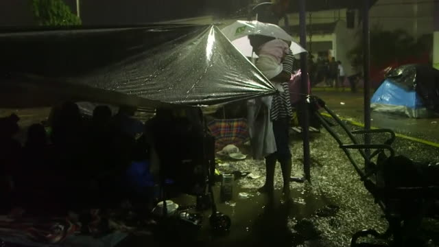 central american migrants set up camp in mexico at night, on their way to the united states - foot stock videos & royalty-free footage