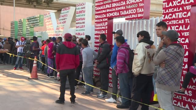 central american migrants wait in line outside a us port of entry in the mexican border city of tijuana hoping to apply for asylum or secure another... - mexican american stock videos & royalty-free footage