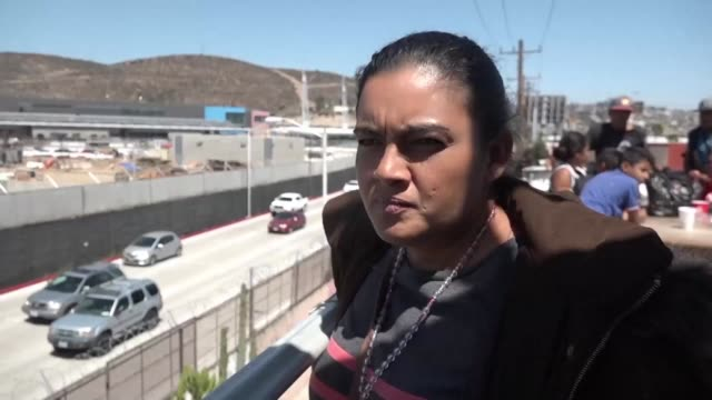 central american migrants who are part of a us bound caravan of 120 migrants prepare themselves for the asylum application process - convoy stock videos & royalty-free footage