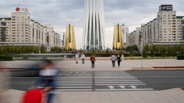 central asia, kazakhstan, astana, bayterek tower and the twin golden conical business centres - time lapse - kazakhstan stock videos & royalty-free footage