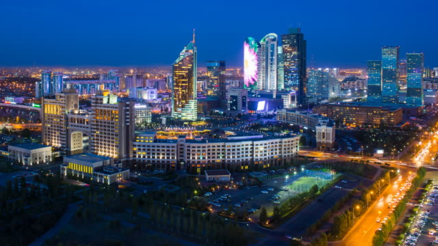 Central Asia, Kazakhstan, Astana, elevated night view over the city center and central business district- Time lapse