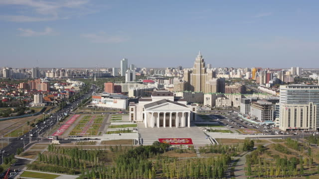 central asia, kazakhstan, astana, elevated view over the city center and opera theater building - kazakhstan stock videos and b-roll footage