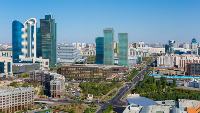 central asia, kazakhstan, astana, elevated view over the city center and central business district- time lapse - kazakhstan stock videos & royalty-free footage
