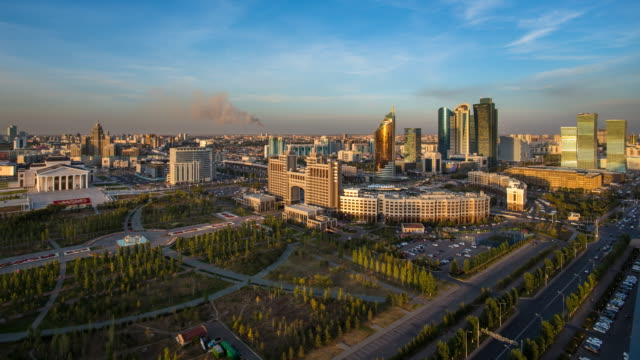 central asia, kazakhstan, astana, elevated view over the city center and central business district- day to night time lapse transistion - kazakhstan stock videos & royalty-free footage